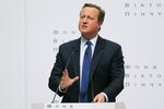 FILE - In this Wednesday, March 29, 2017 file photo Britain's former Prime Minister David Cameron gestures as he delivers a public lecture