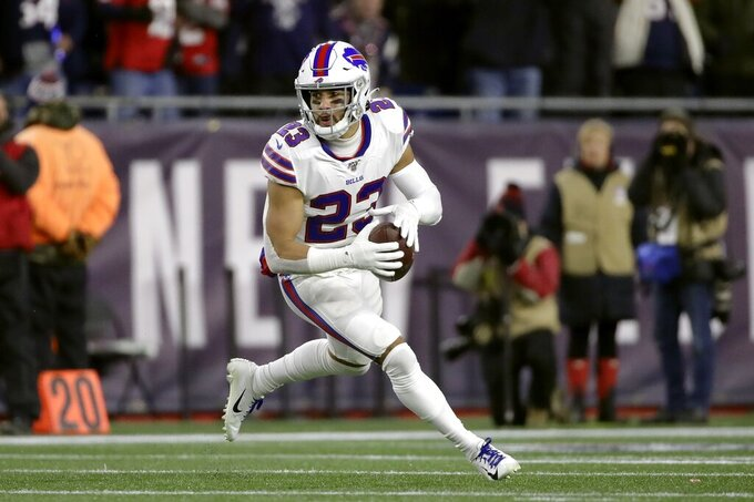 Buffalo Bills safety Micah Hyde carries the ball after recovering a fumble by New England Patriots running back Rex Burkhead in the first half of an NFL football game, Saturday, Dec. 21, 2019, in Foxborough, Mass. (AP Photo/Elise Amendola)