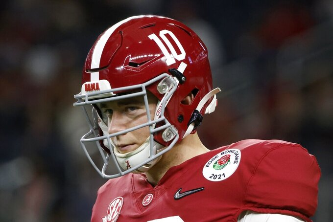 Alabama quarterback Mac Jones warms up before their Rose Bowl NCAA college football game against Notre Dame in Arlington, Texas, Friday, Jan. 1, 2021. (AP Photo/Michael Ainsworth)