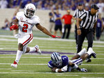 South Dakota running back Kai Henry (2) gets past Kansas State defensive back Eli Walker (7) as he runs for a first down during the first half of an NCAA college football game Saturday, Sept. 1, 2018, in Manhattan, Kan. (AP Photo/Charlie Riedel)