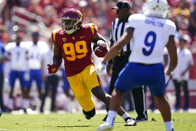 Southern California linebacker Drake Jackson (99) runs the ball after catching an interception during the first half of an NCAA college football game against San Jose State Saturday, Sept. 4, 2021, in Los Angeles. (AP Photo/Ashley Landis)