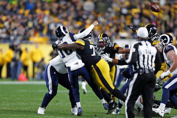 CORRECTS TO FUMBLE, INSTEAD OF INTERCEPTION - Los Angeles Rams quarterback Jared Goff (16) is hit by Pittsburgh Steelers nose tackle Javon Hargrave (79), fumbling the ball, which Minkah Fitzpatrick returned for a touchdown during the first half of an NFL football game in Pittsburgh, Sunday, Nov. 10, 2019. (AP Photo/Keith Srakocic)