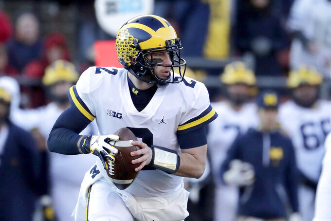 Michigan quarterback Shea Patterson looks to pass against Rutgers during the first half of an NCAA college football game, Saturday, Nov. 10, 2018, in Piscataway, N.J. (AP Photo/Julio Cortez)