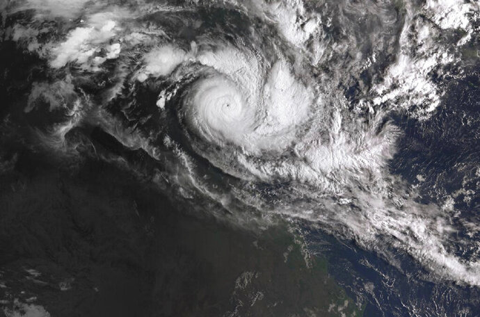 In a satellite image acquired from the Australian Bureau of Meteorology, Cyclone Trevor moves over the Northern Territory captured at 0810am AEDT, Tuesday, 19 March 2019. Australia is evacuating about 2,000 people from parts of northern Australia ahead of the cyclone with winds gusting up to 160 miles an hour (260 kph) expected to hit on Saturday. (Bureau of Meteorology/AAP Image via AP)