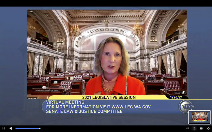 In this still image taken from video by TVW, Washington state's public affairs network, Washington Sen. Patty Kuderer, D-Bellevue, is shown against a virtual background as she speaks, Tuesday, Jan. 26, 2021, during a remote public hearing of the Senate Law & Justice Committee in Olympia, Wash. Kuderer is the sponsor of a measure that would ban the open carry of guns and other weapons on the Washington state Capitol campus and at or near any public demonstration across Washington state. (TVW via AP)