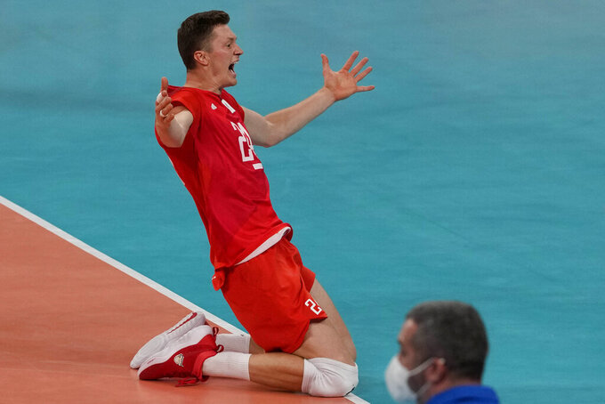 Igor Kobzar, of the Russian Olympic Committee, celebrates winning the men's volleyball semifinal match between Brazil and Russian Olympic Committee at the 2020 Summer Olympics, Thursday, Aug. 5, 2021, in Tokyo, Japan. (AP Photo/Frank Augstein)