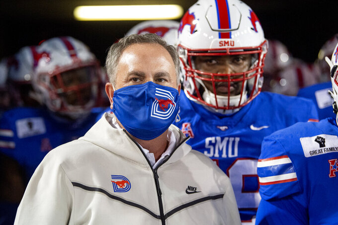 SMU head coach Sonny Dykes prepares to lead his team onto the field before an NCAA college football game against Cincinnati, Saturday, Oct. 24, 2020, in Dallas. (AP Photo/Jeffrey McWhorter)
