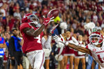 FILE - In this Oct. 26, 2019, file photo, Alabama wide receiver Jerry Jeudy (4) catches a touchdown pass against Arkansas during the second half of an NCAA college football game in Tuscaloosa, Ala. This year's NFL draft features a superb group of wide receivers, including Jeudy, who are expected to make immediate impacts in the NFL. (AP Photo/Vasha Hunt, File)