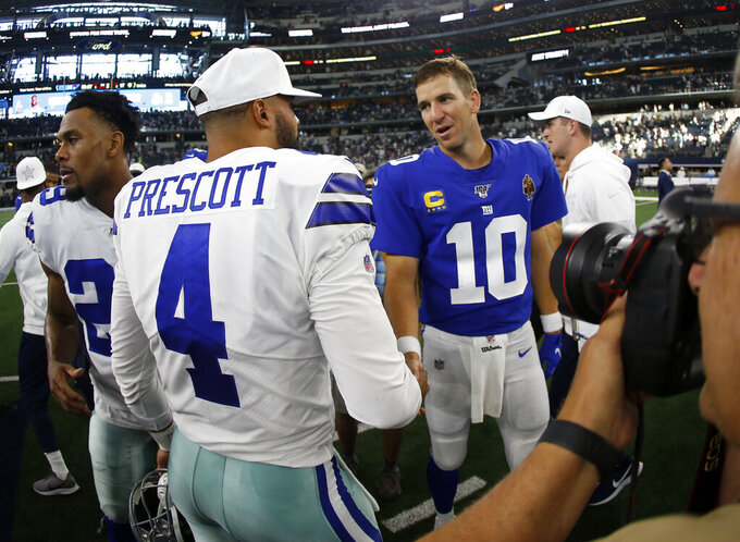 Dallas Cowboys' Dak Prescott (4) and New York Giants' Eli Manning (10) greet each other after their NFL football game in Arlington, Texas, Sunday, Sept. 8, 2019. (AP Photo/Ron Jenkins)