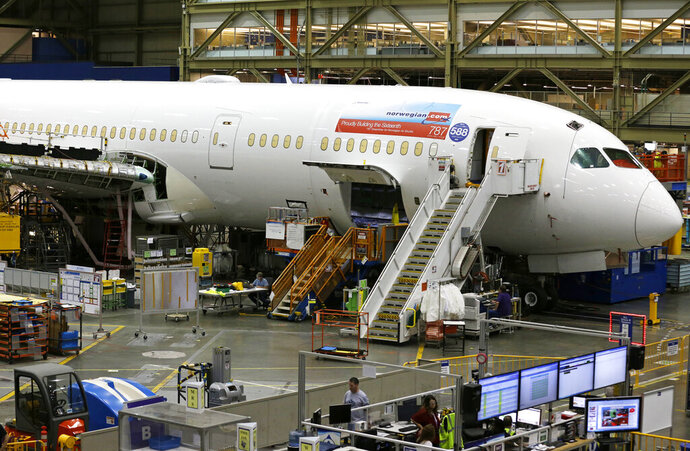 FILE - In this file photo dated Monday, June 12, 2017, showing a Boeing 787 airplane being built for Norwegian Air Shuttle is shown at Boeing Co.'s assembly facility, in Everett, Wash, USA. Low-cost carrier Norwegian Air Shuttle said Thursday Jan. 14, 2021, it will focus on European destinations and close its long-haul operations as it struggles with the fallout of the coronavirus pandemic and debt restructuring. (AP Photo/Ted S. Warren, FILE)