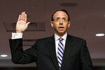 Former Deputy Attorney General Rod Rosenstein is sworn in before a Senate Judiciary Committee hearing on Capitol Hill in Washington, Wednesday, June 3, 2020. (Jim Lo Scalzo/Pool via AP)