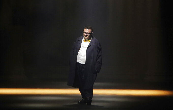 """FILE - In this file photo dated Thursday, Oct. 1, 2015, Israeli fashion designer Alber Elbaz acknowledges applause at the end of his Spring-Summer 2016 ready-to-wear fashion collection for Lanvin, presented during the Paris Fashion Week, in Paris. Elbaz, best known for being at the helm of Lanvin from 2001 to 2015, has died at the age of 59, luxury conglomerate Richemont said. Fashion French daily Women's Wear Daily said Elbaz died on Saturday, April 24, 2021 at a Paris hospital. In a statement released on Sunday, Richemont's chairman Johann Rupert said """"it was with shock and enormous sadness that I heard of Alber's sudden passing. Alber had a richly deserved reputation as one of the industry's brightest and most beloved figures."""" (AP Photo/Thibault Camus, File)"""