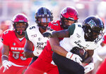 UNLV linebacker Austin Ajiake (27) tackles Hawaii wide receiver Cedric Byrd II (6) in the second quarter of an NCAA college football game Saturday, Nov. 16, 2019, in Las Vegas. (Benjamin Hager/Las Vegas Review-Journal via AP)