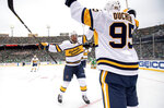 Nashville Predators left wing Filip Forsberg (9) celebrates with center Matt Duchene (95) after Duchene's goal against the Dallas Stars in the first period of the NHL Winter Classic hockey game between the Dallas Stars and the Nashville Predators at the Cotton Bowl, Wednesday, Jan. 1, 2020, in Dallas. (AP Photo/Jeffrey McWhorter)