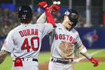 Boston Red Sox's Jarren Duran (40) celebrates with Enrique Hernandez after Hernandez hit a home run during the sixth inning of a baseball game against the Toronto Blue Jays on Monday, July 19, 2021, in Buffalo, N.Y. (AP Photo/Joshua Bessex)