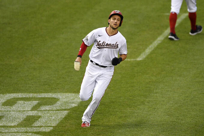 Washington Nationals'Trea Turner runs towards home to score on a single by Adam Eaton during the third inning of a baseball game against the Toronto Blue Jays, Tuesday, July 28, 2020, in Washington. (AP Photo/Nick Wass)