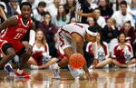Boston University's Jonas Harper (15) and Colgate's Jordan Burns (1) chase after the ball during the first half of the NCAA Patriot League Conference college basketball championship at Cotterell Court, Wednesday, March 11, 2020, in Hamilton, N.Y. (AP Photo/John Munson)