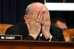 Rep. Louie Gohmert, R-Texas, rubs his face during a House Judiciary Committee markup of the articles of impeachment against President Donald Trump, Wednesday, Dec. 11, 2019, on Capitol Hill in Washington. (AP Photo/Jacquelyn Martin)