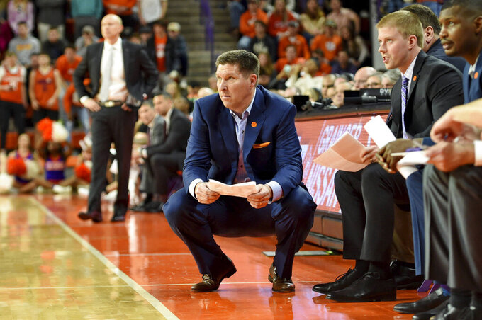 Clemson head coach Brad Brownell, center, watches the action during the first half of an NCAA college basketball game against Louisville, Saturday, Feb. 15, 2020, in Clemson, S.C. (AP Photo/Richard Shiro)