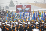 South Korean President Moon Jae-in, on screen, speaks during a ceremony for the 71st anniversary of Armed Forces Day at the Air Force Base in Daegu, South Korea, Tuesday, Oct. 1, 2019. (Jeon Heon-kyun/Pool Photo via AP)