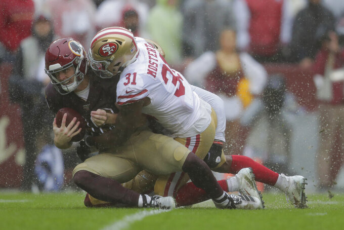 San Francisco 49ers running back Raheem Mostert, right, tackles Washington Redskins wide receiver Trey Quinn in the first half of an NFL football game, Sunday, Oct. 20, 2019, in Landover, Md. (AP Photo/Julio Cortez)