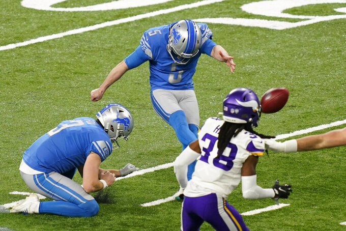 Detroit Lions kicker Matt Prater (5) kicks at 54-yard field goal during the first half of an NFL football game against the Minnesota Vikings, Sunday, Jan. 3, 2021, in Detroit. (AP Photo/Carlos Osorio)