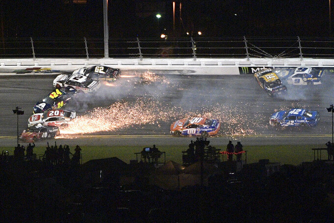 Jamie McMurray (40), Erik Jones (20), William Byron (24), Brad Keselowski (2), Brendan Gaughan (62), Clint Bowyer (14) and Chase Elliott (9) collide in Turn 3 during the NASCAR Daytona 500 auto race at Daytona International Speedway Sunday, Feb. 17, 2019, in Daytona Beach, Fla. (AP Photo/Phelan M. Ebenhack)