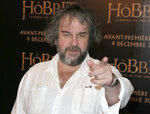 FILE - In this Dec. 4, 2014, file photo, director Peter Jackson poses for photos at the screening of his film The Hobbit. Amazon announced Wednesday, Sept. 18, 2019, it will film its upcoming television series