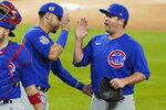 Chicago Cubs relief pitcher Andrew Chafin, right, celebrates with Willson Contreras after they defeated the Chicago White Sox in a baseball game in Chicago, Friday, Sept. 25, 2020. (AP Photo/Nam Y. Huh)