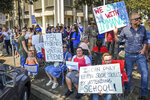 FILE - In this Aug. 25, 2020 file photo hundreds of Immanuel Schools supporters hold signs and gather outside the B.F. Sisk Courthouse in support of the schools' decision to defy the county's COVID-19 orders prior to a court hearing in Fresno, Calif. The California private school has been ordered to pay $15,000 for defying a judge's order to close classrooms and stop in-person teaching. The decision Tuesday, Oct. 20, 2020, in the Fresno County Superior Court ends a nearly three-month legal battle between Immanuel Schools, a private K-12 Christian school in California's Central Valley, and county and state officials. (Craig Kohlruss/The Fresno Bee via AP, File)