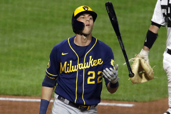 Milwaukee Brewers' Christian Yelich tosses his bat as he walks back to the dugout after striking out looking against Pittsburgh Pirates relief pitcher Robbie Erlin during the seventh inning of a baseball game in Pittsburgh, Wednesday, July 29, 2020. (AP Photo/Gene J. Puskar)