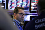 Trader Leon Montana works on the floor of the New York Stock Exchange, Friday, Feb. 28, 2020. Stocks are opening sharply lower on Wall Street, putting the market on track for its worst week since October 2008 during the global financial crisis. (AP Photo/Richard Drew)
