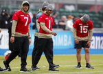 Jaguars quarterbacks Joshua Dobbs, centre, Nick Foles, left, and Gardner Minshew II warm up during a NFL training session of the Jacksonville Jaguars at the at Allianz Park in London, Friday, Nov. 1, 2019.The Jacksonville Jaguars are preparing for an NFL regular season game against the Houston Texans in London on Sunday. (AP Photo/Frank Augstein)
