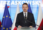 Warsaw Mayor Rafal Trzaskowski concedes defeat in Poland's tight presidential election runoff and congratulates President Andrzej Duda for winning a second term, in Warsaw, Poland, Monday, July 13, 2020.(AP Photo/Czarek Sokolowski)