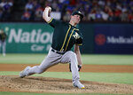 Oakland Athletics starting pitcher Chris Bassitt throws to the Texas Rangers in the fourth inning of the second baseball game of a doubleheader in Arlington, Texas, Saturday, June 8, 2019. (AP Photo/Tony Gutierrez)