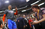Oklahoma City Thunder's Russell Westbrook gets into a heated verbal altercation with fans in the first half of an NBA basketball game against the Utah Jazz, Monday, March 11, 2019, in Salt Lake City. (AP Photo/Rick Bowmer)