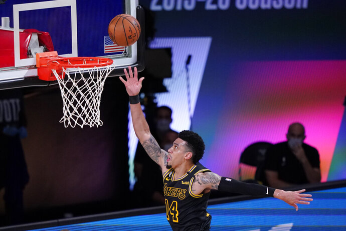 Los Angeles Lakers' Danny Green (14) drives to the basket during the first half of an NBA conference final playoff basketball game against the Denver Nuggets Sunday, Sept. 20, 2020, in Lake Buena Vista, Fla. (AP Photo/Mark J. Terrill)