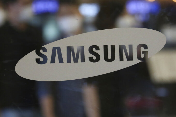 The logo of the Samsung Electronics Co. is seen at its shop in Seoul, South Korea, Tuesday, July 7, 2020. Samsung Electronics Co. said Tuesday its operating profit for the last quarter likely rose 23% from the same period last year, helped by robust demand for memory chips used in personal computers and servers as the coronavirus pandemic has more people working from home. (AP Photo/Ahn Young-joon)