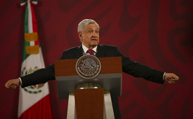 Mexico's President Andres Manuel Lopez Obrador gives his daily, morning news conference at the presidential palace, Palacio Nacional, in Mexico City, Monday, July 13, 2020. (AP Photo/Marco Ugarte)