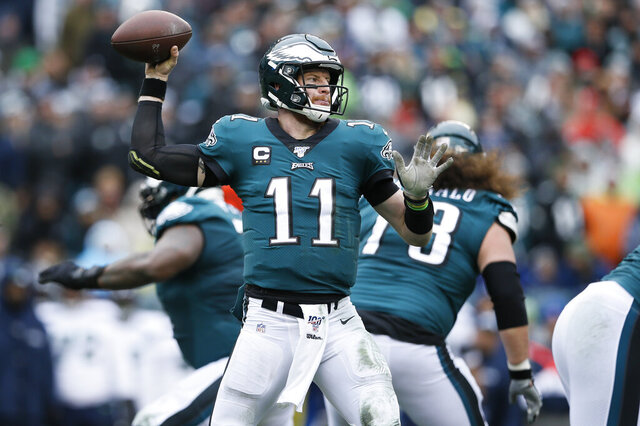 Philadelphia Eagles' Carson Wentz passes during the first half of an NFL football game against the Seattle Seahawks, Sunday, Nov. 24, 2019, in Philadelphia. (AP Photo/Michael Perez)