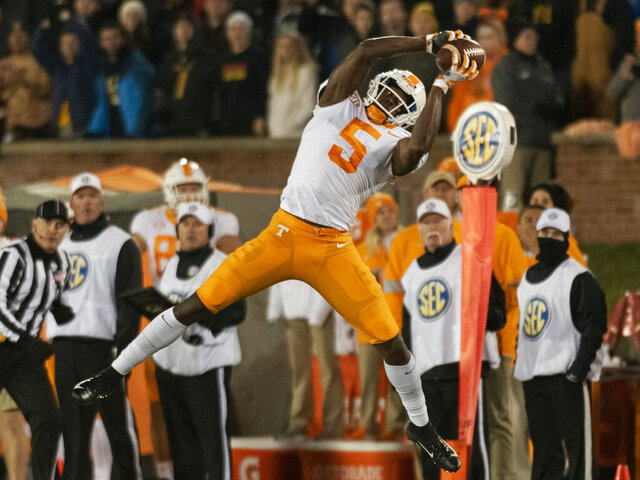 FILE - Tennessee wide receiver Josh Palmer pulls down a reception during the first quarter of the teams NCAA college football game against Missouri, Saturday, Nov. 23, 2019, in Columbia, Mo. Tennessee has to fill the void left by the loss of Jajuan Jennings and Marquez Callaway. (AP Photo/L.G. Patterson, File)