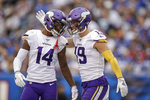 Minnesota Vikings wide receiver Adam Thielen (19) celebrates with wide receiver Stefon Diggs (14) after catching a touchdown pass against the New York Giants during the third quarter of an NFL football game, Sunday, Oct. 6, 2019, in East Rutherford, N.J. (AP Photo/Adam Hunger)