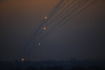 Rockets are launched from Gaza Strip to Israel, Sunday, May 5, 2019. Palestinian militants in the Gaza Strip on Sunday intensified a wave of rocket fire into southern Israel, striking towns and cities across the region while Israeli forces struck dozens of targets throughout Gaza, including militant sites that it said were concealed in homes or residential areas. (AP Photo/Ariel Schalit)