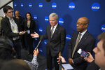 NCAA President Mark Emmert, center, speaks to reporters alongside Michael V. Drake, right, chair of the board and president of The Ohio State University, at the NCAA convention Thursday, Jan. 23, 2020, in Anaheim, Calif. (AP Photo/Mark J. Terrill)