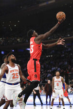 Toronto Raptors' Pascal Siakam (43) drives past New York Knicks' Reggie Bullock (25) during the first half of an NBA basketball game Friday, Jan. 24, 2020, in New York. (AP Photo/Frank Franklin II)