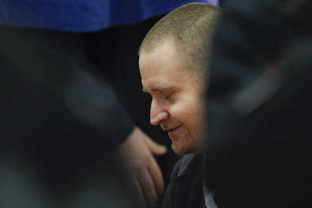 In this file picture taken on Thursday, Dec. 19, 2019, Miroslav Marcek, one of the suspected shooters in the slaying of an investigative journalist Jan Kuciak and his fiancee Martina Kusnirova sits in a courtroom ahead of the trial in Pezinok, Slovakia. On Monday April 6, 2020, a court in Slovakia has convicted Miroslav Marcek, a former soldier, of murder of an investigative journalist and his fiancee and sentenced him to 23 years in prison. (AP Photo/Petr David Josek/File)