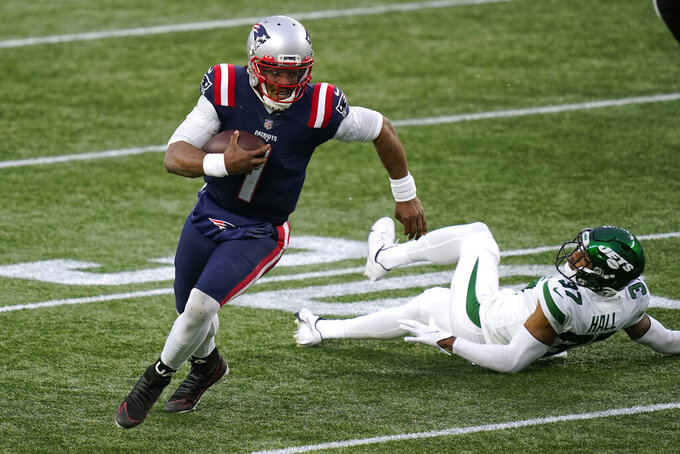 New England Patriots quarterback Cam Newton runs from New York Jets cornerback Bryce Hall in the second half of an NFL football game, Sunday, Jan. 3, 2021, in Foxborough, Mass. (AP Photo/Elise Amendola)