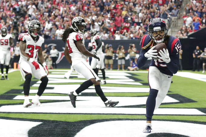 Houston Texans wide receiver Will Fuller (15) catches a pass for a touchdown against the Atlanta Falcons during the first half of an NFL football game Sunday, Oct. 6, 2019, in Houston. (AP Photo/David J. Phillip)