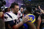 New England Patriots' Tom Brady (12) talks to Los Angeles Rams' Dante Fowler (56), after the NFL Super Bowl 53 football game Sunday, Feb. 3, 2019, in Atlanta. The Patriots won 13-3.(AP Photo/Jeff Roberson)