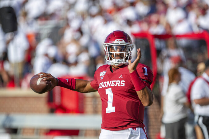 Oklahoma quarterback Jalen Hurts (1) warms up before the start of an NCAA college football game against Houston in Norman, Okla., Sunday, Sept. 1, 2019. (AP Photo/Alonzo Adams)